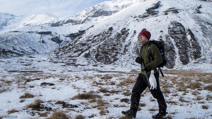 ptarmigan hunter in snow