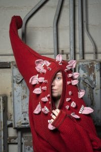 Textile designer Ýr Jóhannsdóttir wearing one of her own creations, a sweater decorated with knitted tongues.