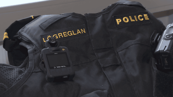 A body camera attached to a police vest.