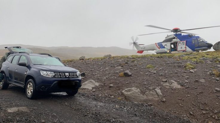 The Iceland Coast Guard Hleicopter was dispatched to come to the aid of three tourists who were stuck as flooding had ruptured the road back to Reykjavík.