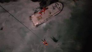 sailor rescued by helicopter.