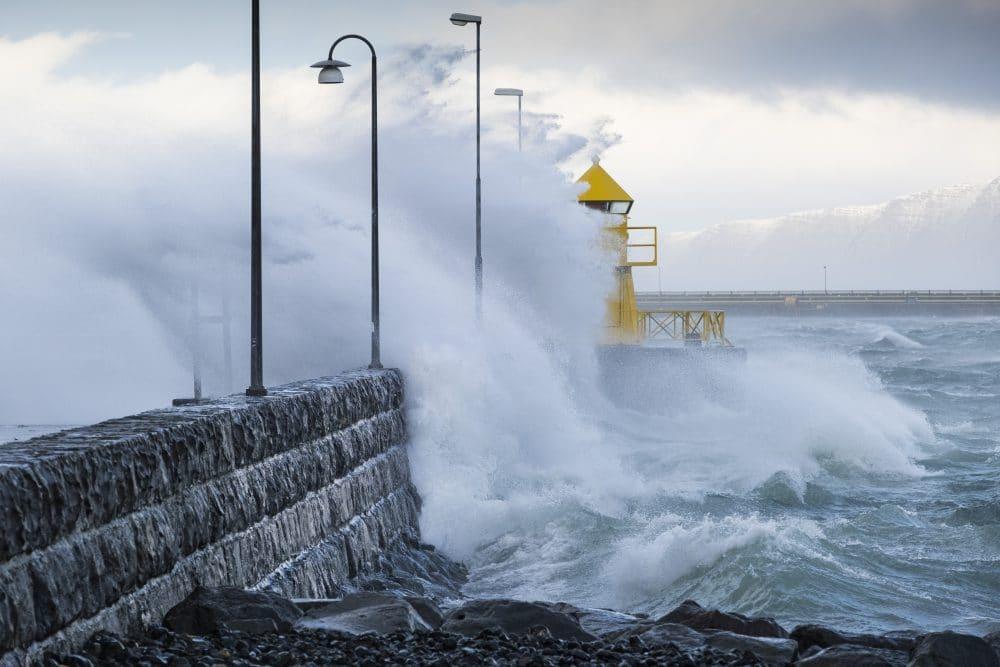 Waves crashing over Reykjavík lighthouse