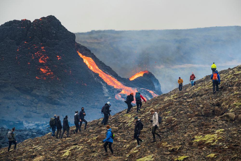 lava-eruption-hikers-camera-tourists.jpg